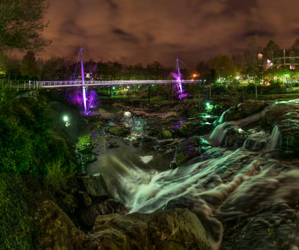 Reedy Falls and Liberty Bridge in Downtown Greenville, South Carolina, USA. Reedy Falls and Liberty Bridge in Downtown Greenville, South Carolina, SC, USA. liberty bridge budapest stock pictures, royalty-free photos & images