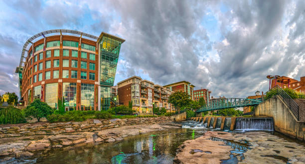 Reedy River Downtown Greenville South Carolina Panorama Reedy River panorama of RiverPlace in downtown Greenville South Carolina SC. liberty bridge budapest stock pictures, royalty-free photos & images