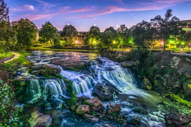 Reedy River Falls Waterfall in Downtown Greenville Falls Park Reedy River Falls Waterfall in Downtown Greenville SC Falls Park at Sunrise. liberty bridge budapest stock pictures, royalty-free photos & images