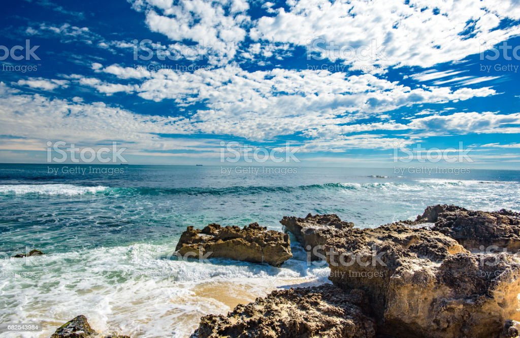 Reef exposed at beach on beautiful sunny autumn day stock photo