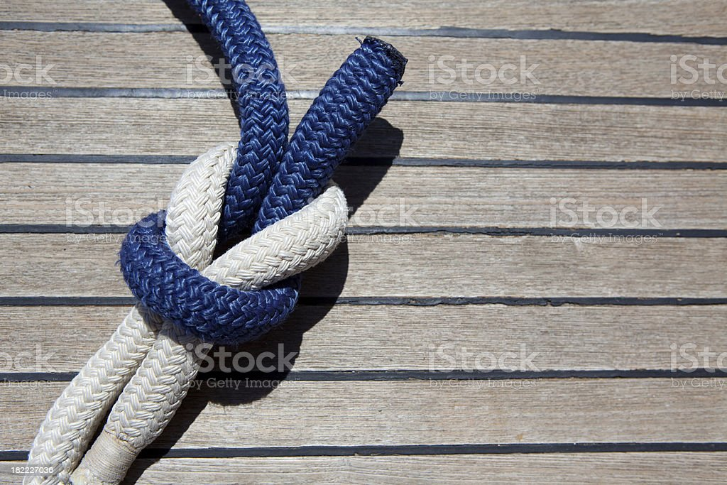 Reef knot on a sail boat deck royalty-free stock photo