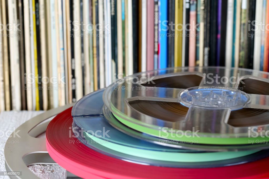 Reel tapes and vinyl records stock photo