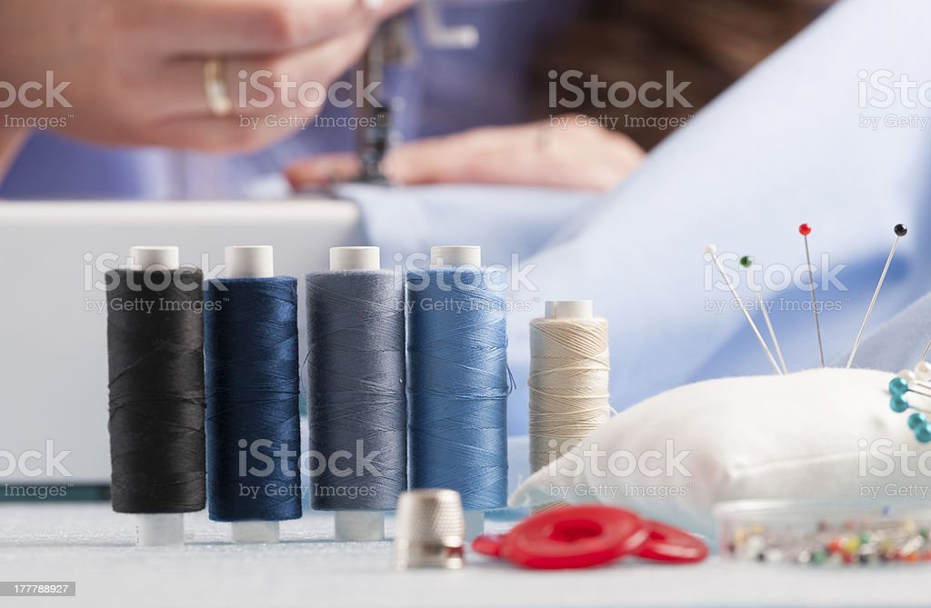 reels of colour threads and sewing accessories royalty-free stock photo