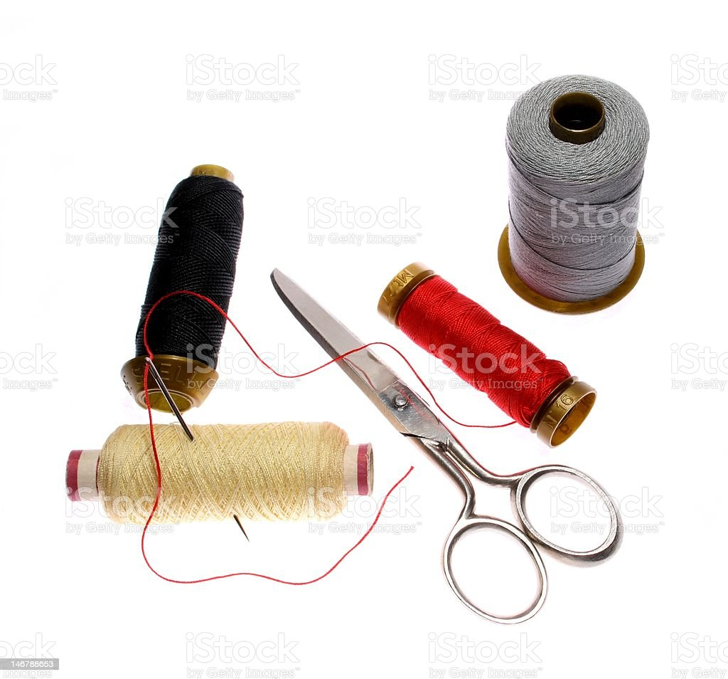 Reels of thread, needle and  scissors royalty-free stock photo