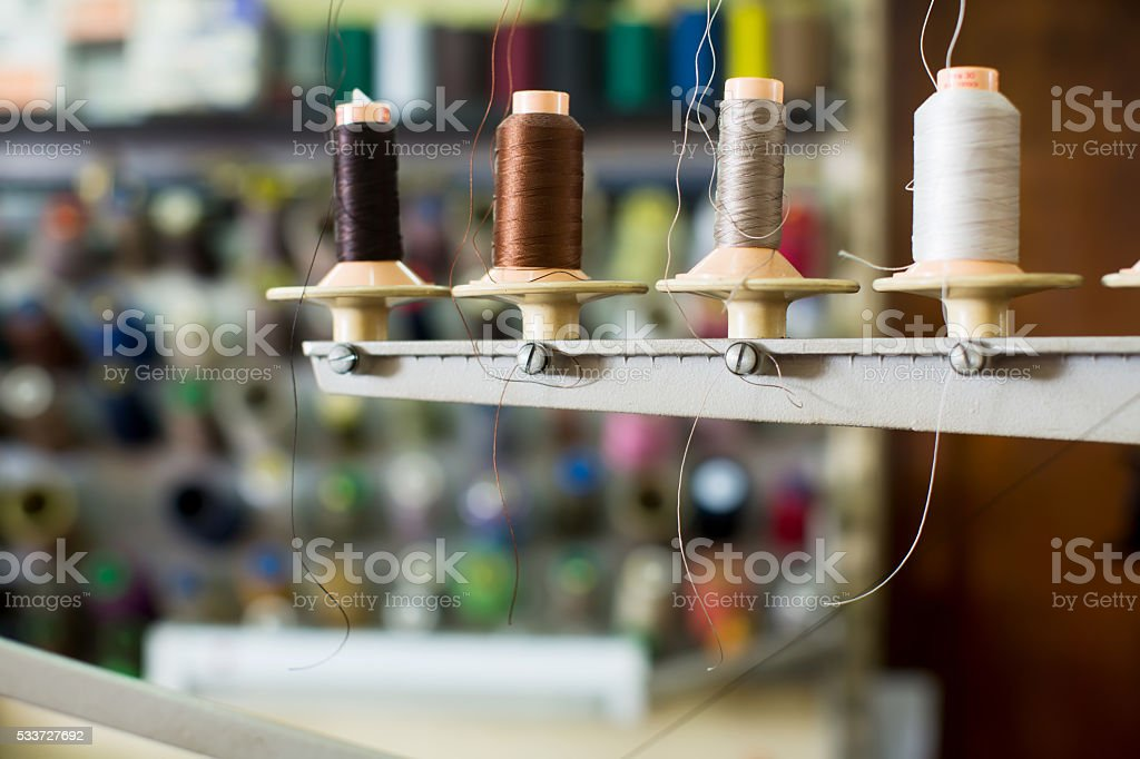 Reels of threads in sewing shop stock photo