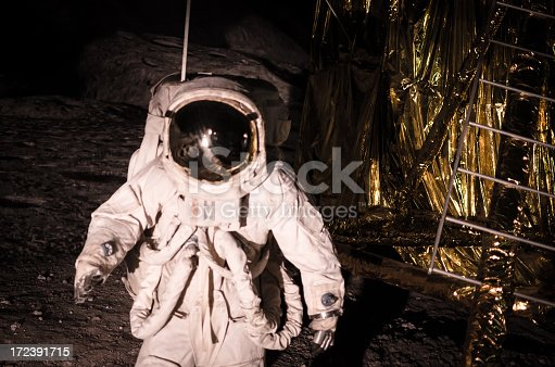 Reenactment of the moon landing during an Apollo mission. Non identifiable model, no model release necessary. Nikon D7000, Nikkor 16-85mm. Strong blur and high grain cause of bad light condition. Soft vintage edit.