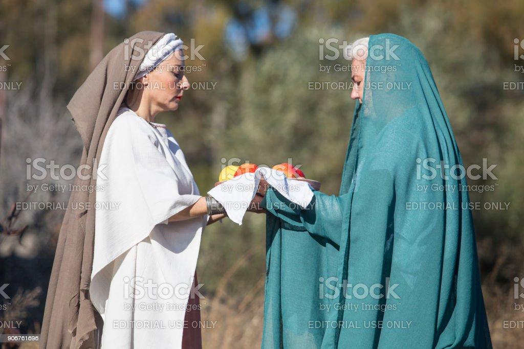 Reenactment of Iberian Goddess Ataecina ritual. Priestess receiving offering from devotee stock photo