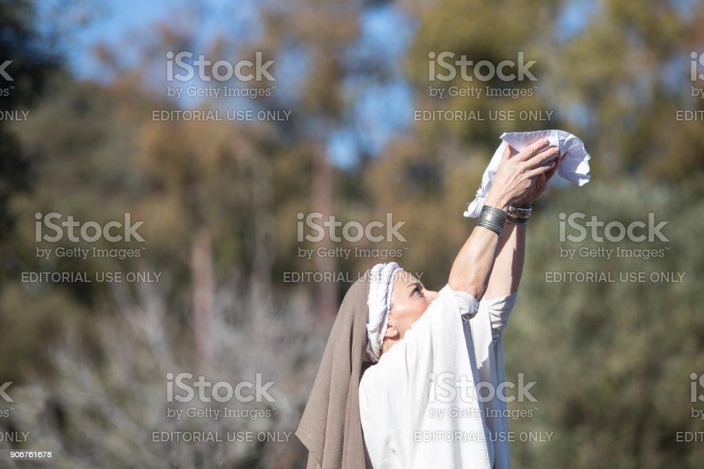 Reenactment of Iberian Goddess Ataecina ritual. Priestess rising arms with offering stock photo