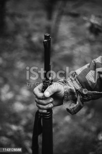 1061204700 istock photo Re-enactor Dressed As World War II German Wehrmacht Soldier Holds Rifle. Photo In Black And White Colors 1143128588