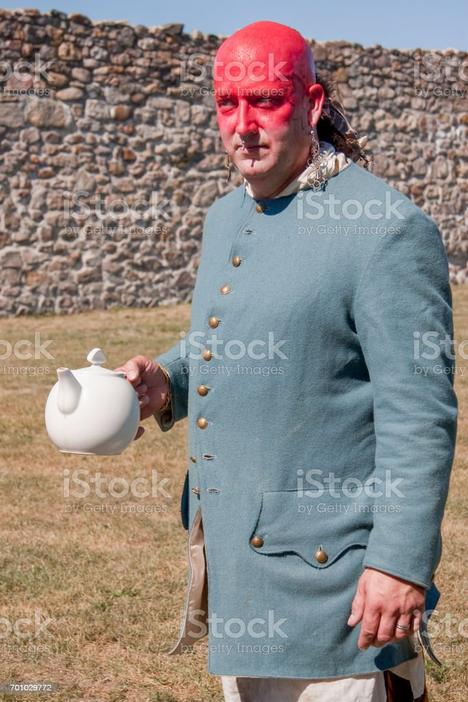 Reenactor Portraying a Shawnee Indian Carrying a Teapot, French and Indian War stock photo