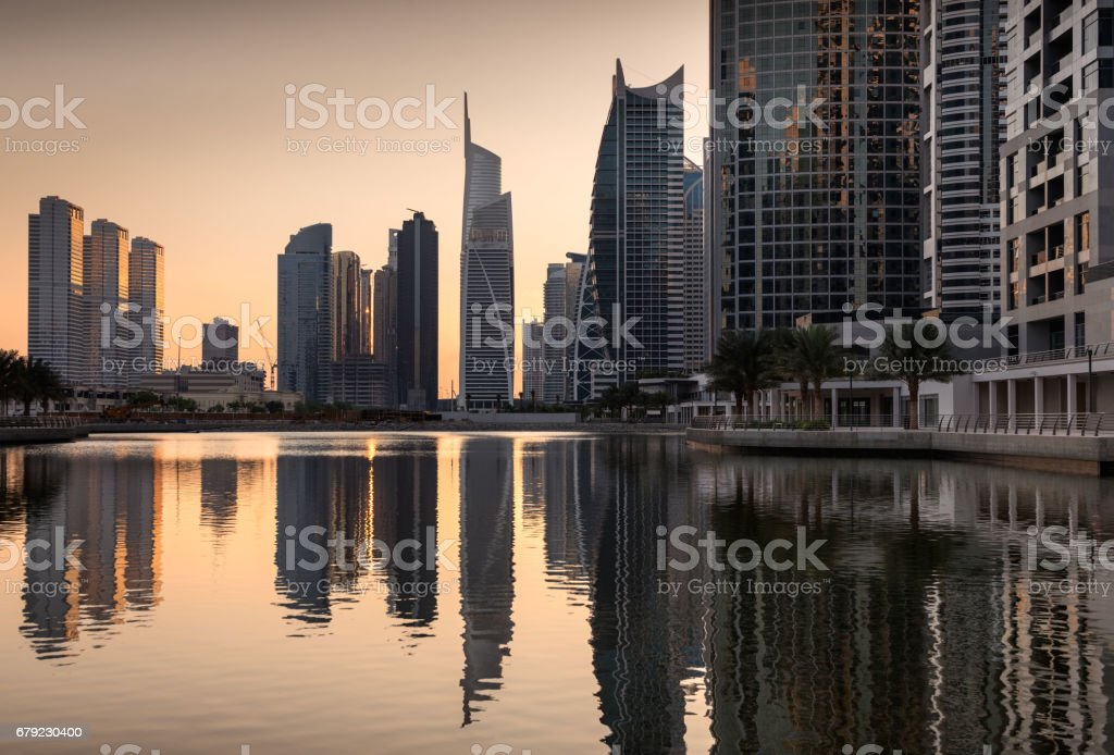 Refelctions of Jumeirah lakes towers at dusk, Dubai, United Arab Emirates stock photo