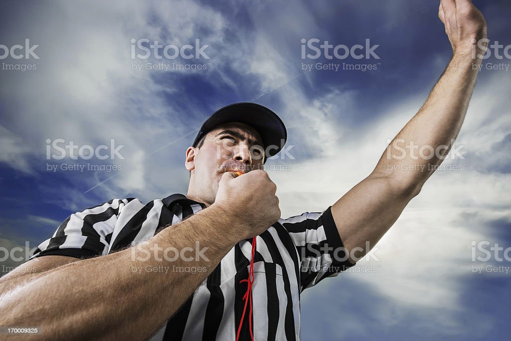 Referee against the clouds. stock photo
