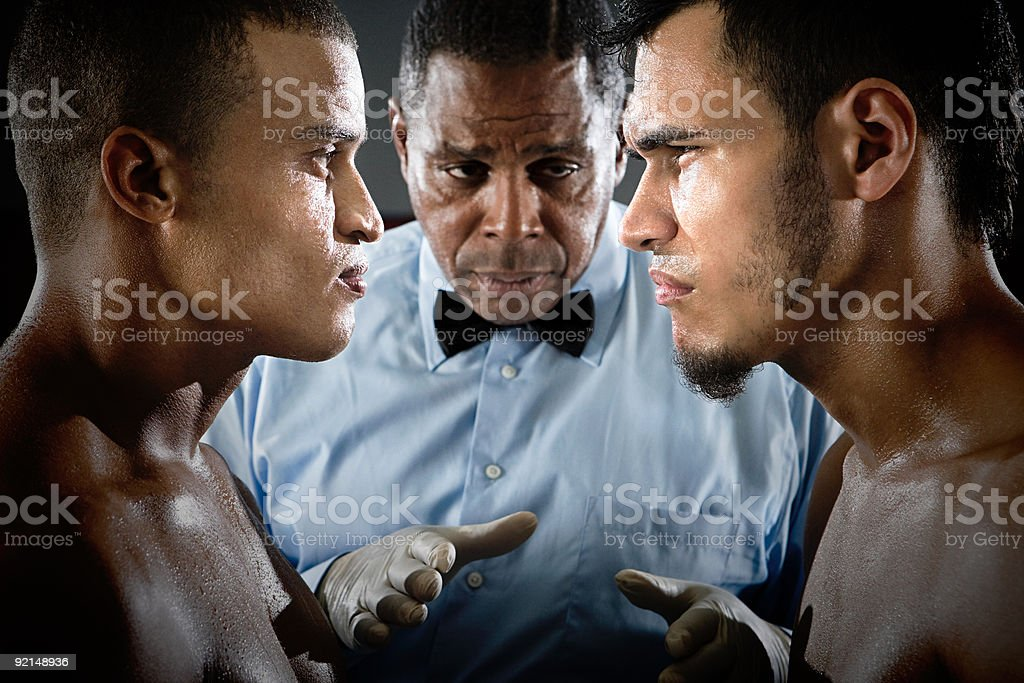 Referee and boxers face to face stock photo