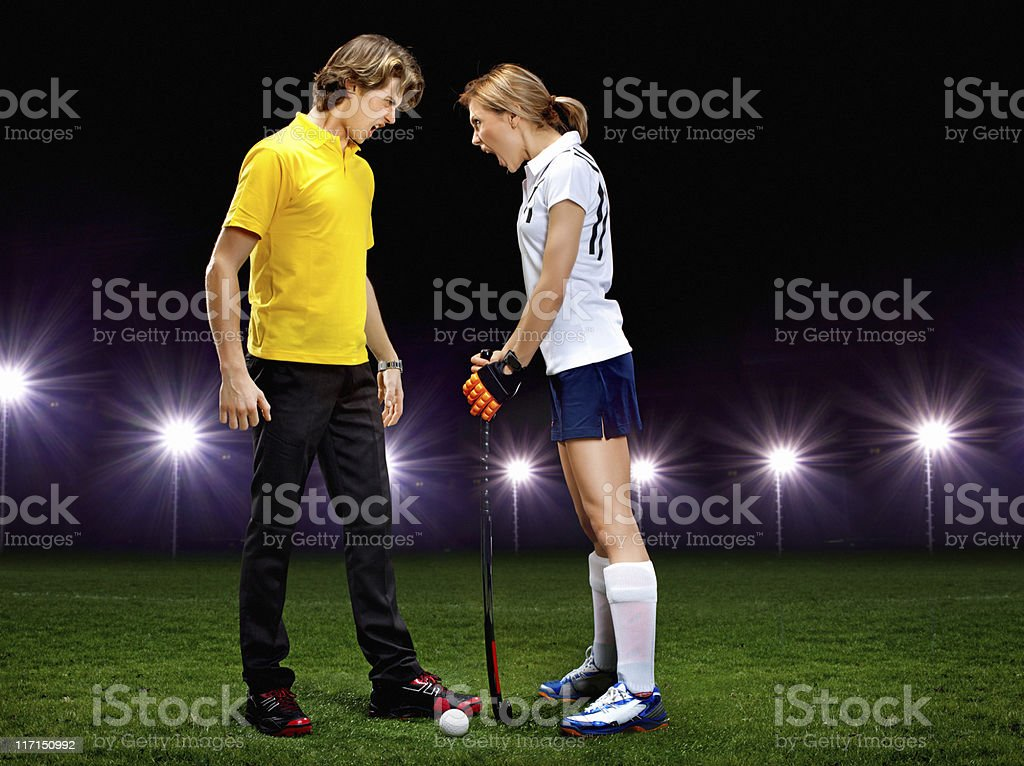 referee and graas hockey player screaming royalty-free stock photo