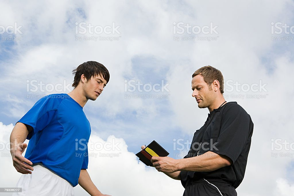 A referee booking a footballer royalty-free 스톡 사진
