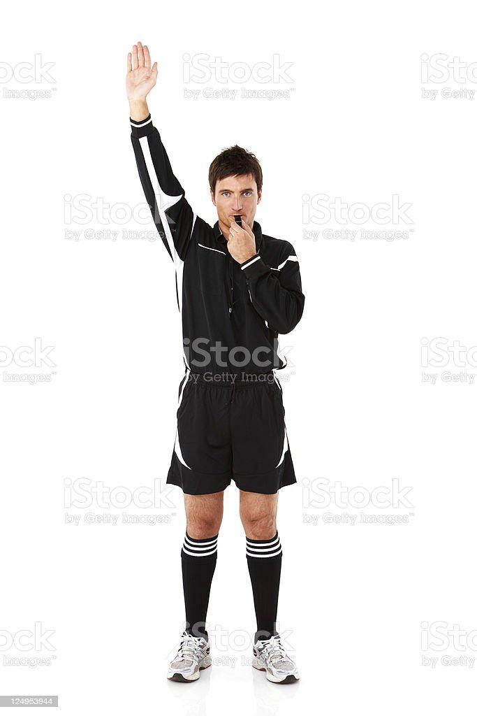 Arbitre appelant une pénalité-isolé - Photo