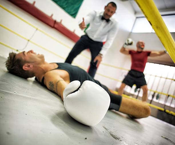 Referee Counting Boxer to the Mat stock photo