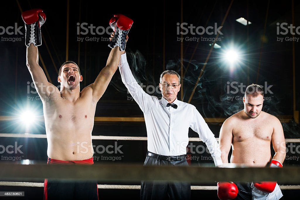 Referee declaring boxing match winner. royalty-free stock photo