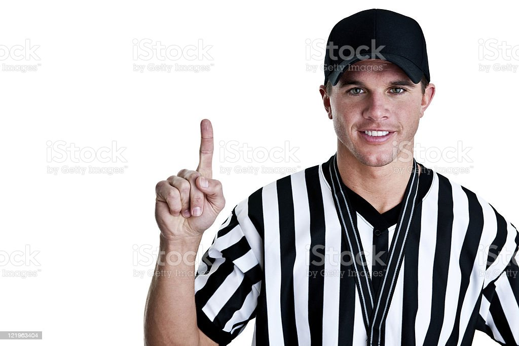 Referee either pointing up to copy space stock photo