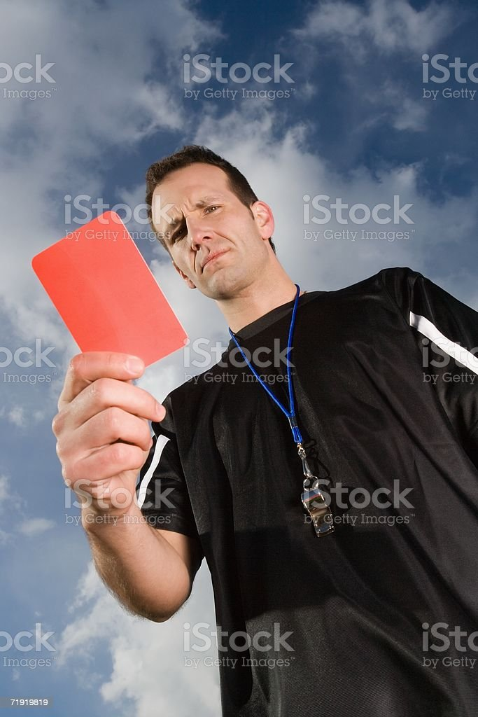 Referee holding red card royalty-free stock photo
