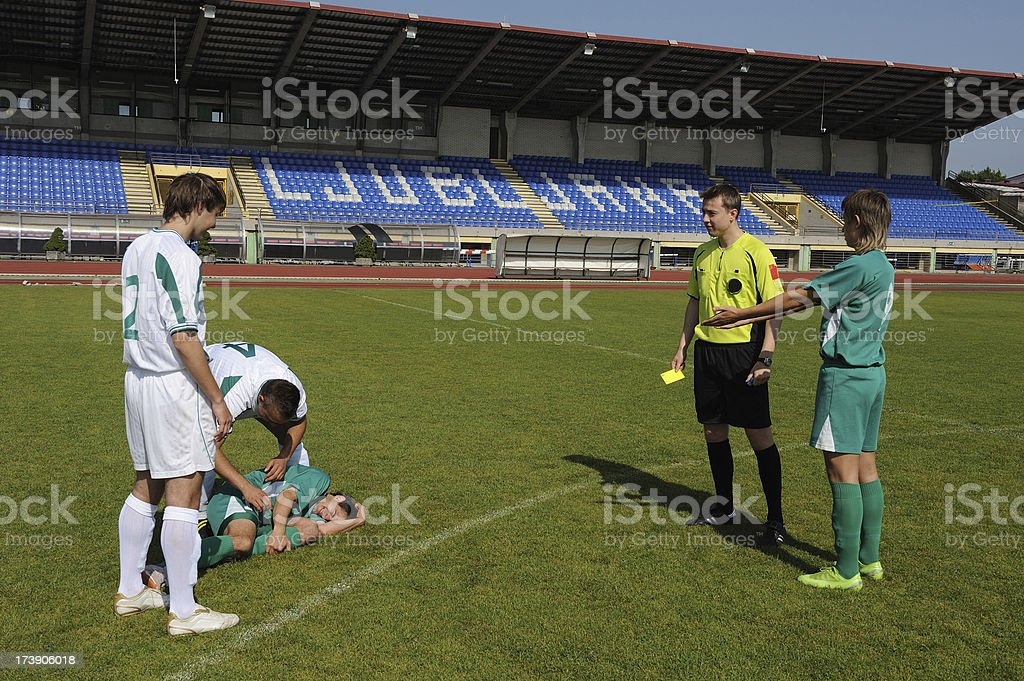 Referee ready for giving yellow card stock photo