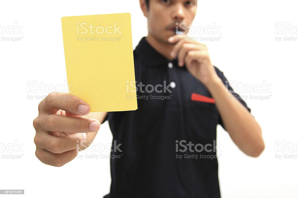Referee showing a yellow card on white background stock photo