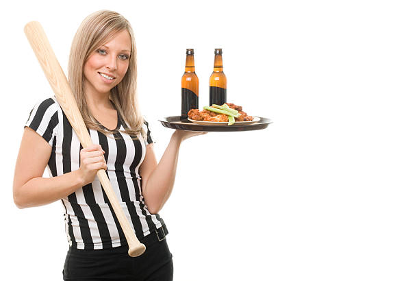 Referee Waitress Holding Bat stock photo