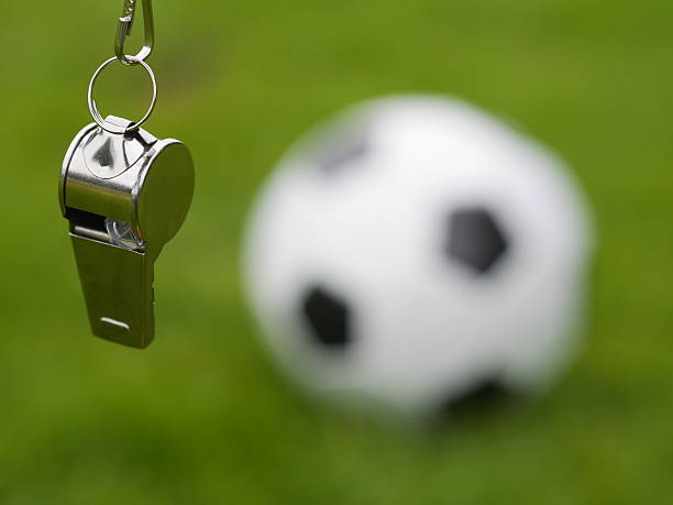 referee whistle referee whistle in front of soccer ball referee stock pictures, royalty-free photos & images