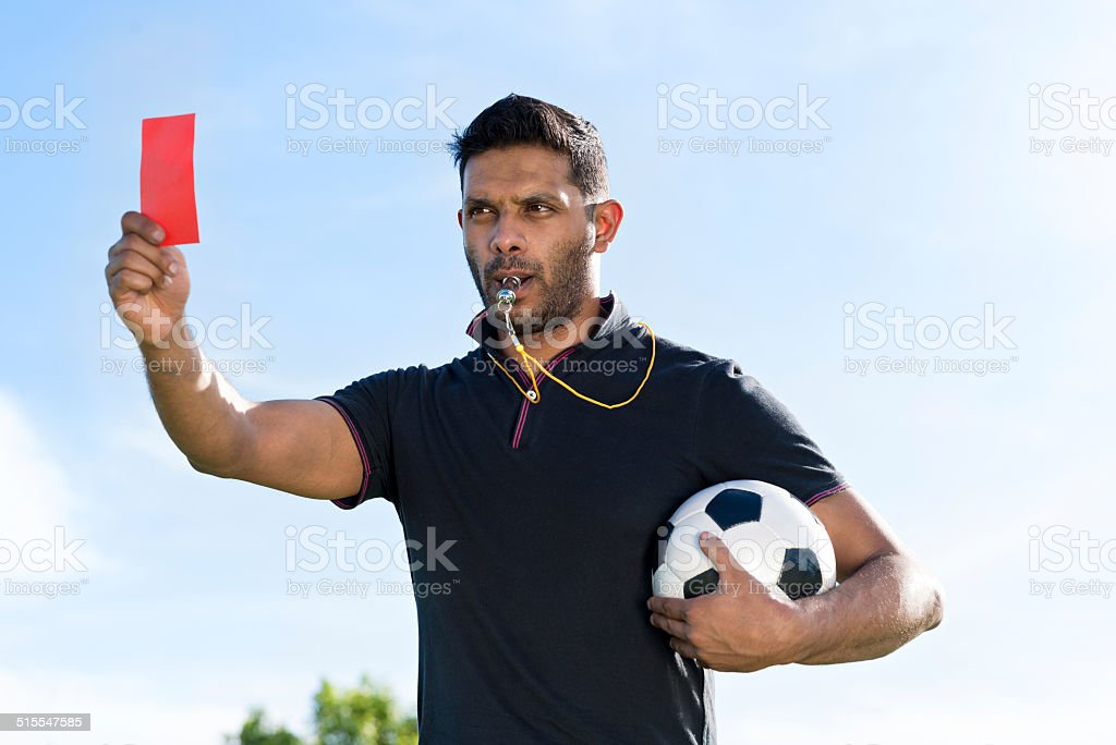 Referee with red card stock photo