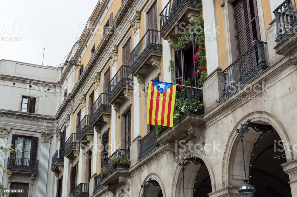 Referendum of independence from Spain. Catalan flag, Senyera hanging from the balcony stock photo
