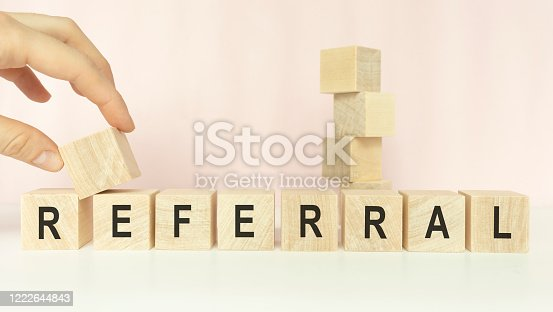 Referral Word In Wooden Cube on a light background