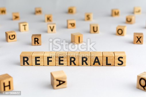 istock referrals - word from wooden blocks with letters 1167366632
