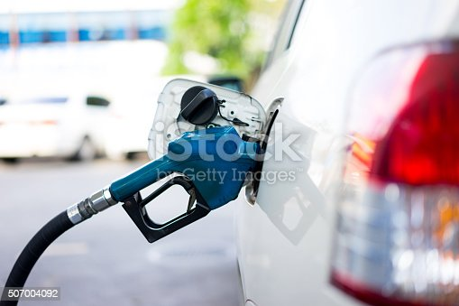 istock Refill fuel to a car at gas station 507004092