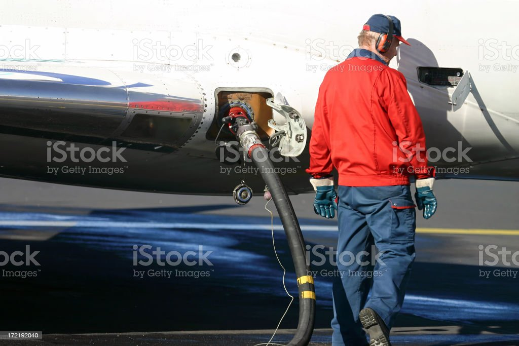 Refilling the airplane's tank stock photo