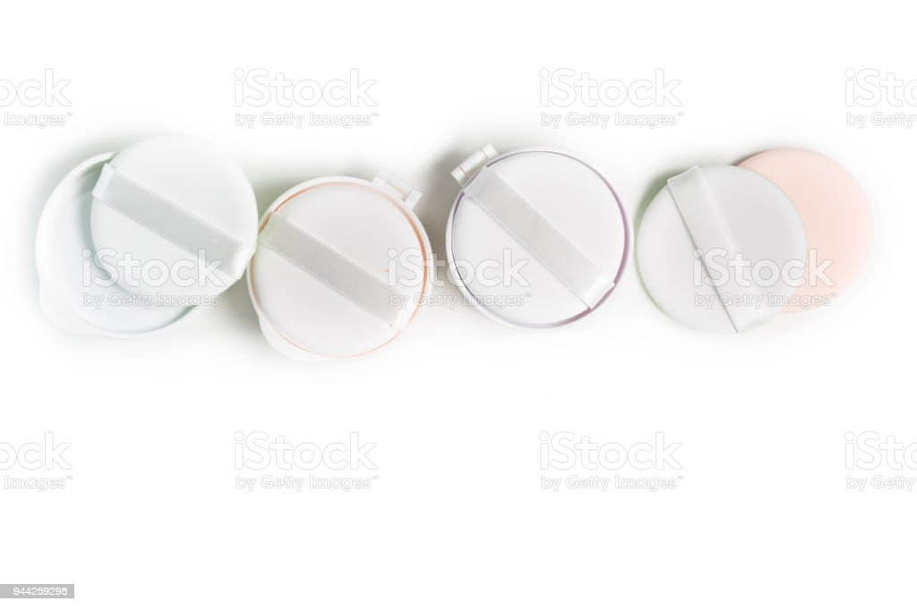Refills of foundation and highlighter cushion on a white background stock photo