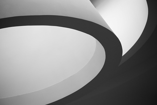 Contemporary architectural fragment resembling conical lampshade. Abstract black-and-white architecture background.