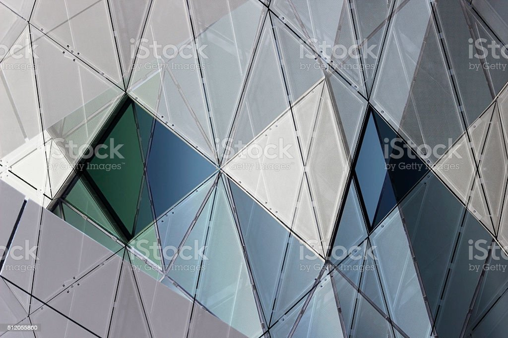 Refined double exposure photo of facade with polygonal pattern stock photo