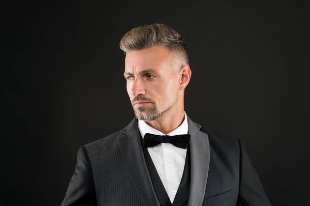 Refinement in every detail. Fashion shop. Rent suit service. Elegant fashion outfit for event. Gentleman modern style. Guy well groomed handsome macho wear tuxedo. Fashion clothes. Tailored suit stock photo