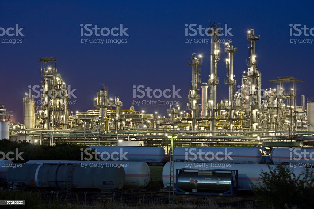 Refinery And Railroad Cars At Night royalty-free stock photo