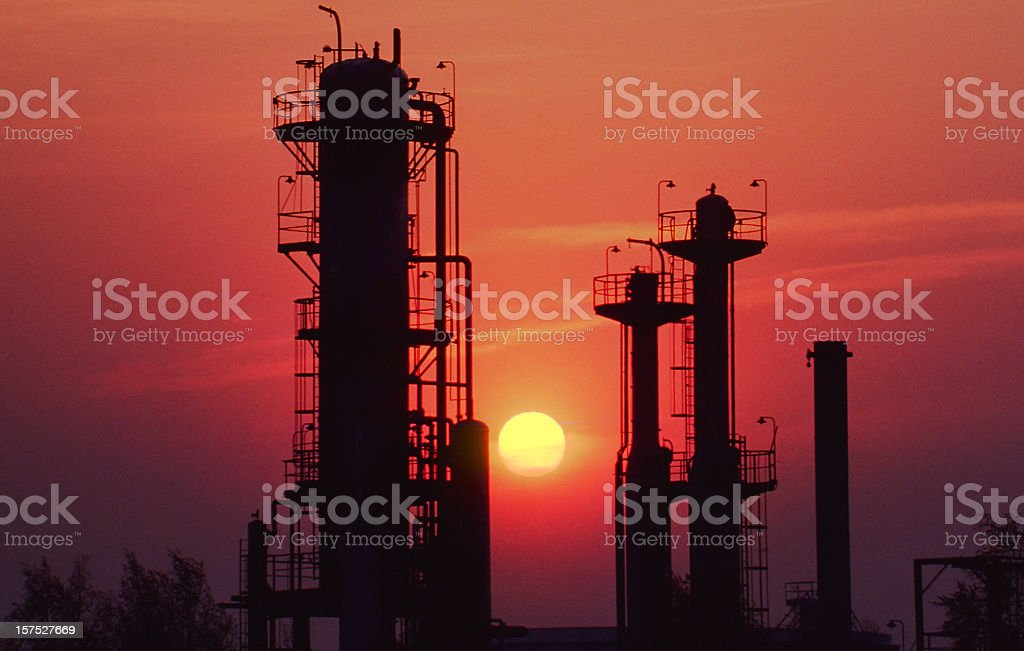 Refinery Backlit by the Setting Sun royalty-free stock photo