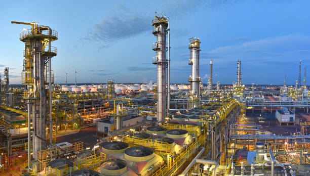 refinery - chemical factory at night with buildings, pipelines and lighting - industrial plant refinery - chemical factory at night with buildings, pipelines and lighting - industrial plant chemical plant stock pictures, royalty-free photos & images