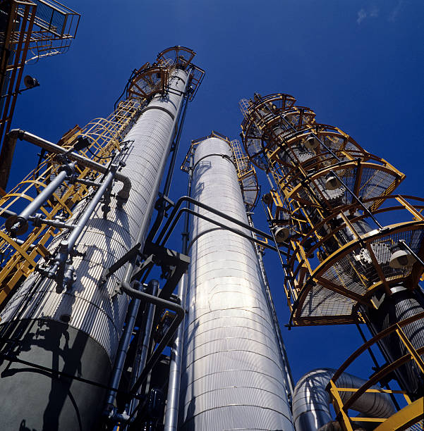 refinery chimneys stock photo