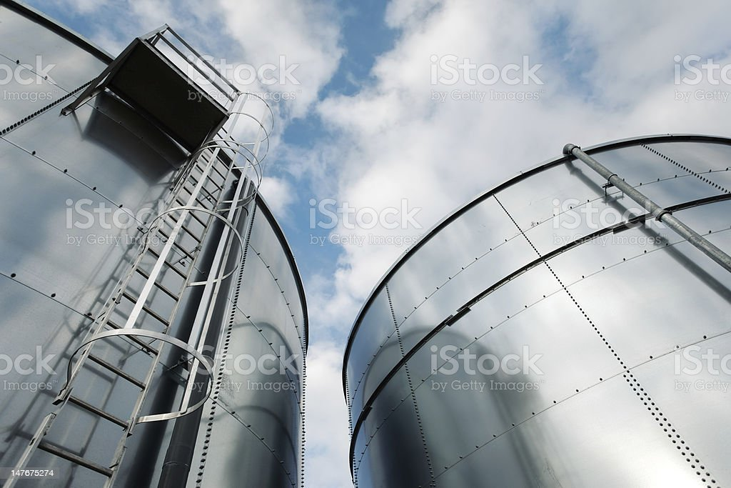 Refinery ladder and tanks stock photo