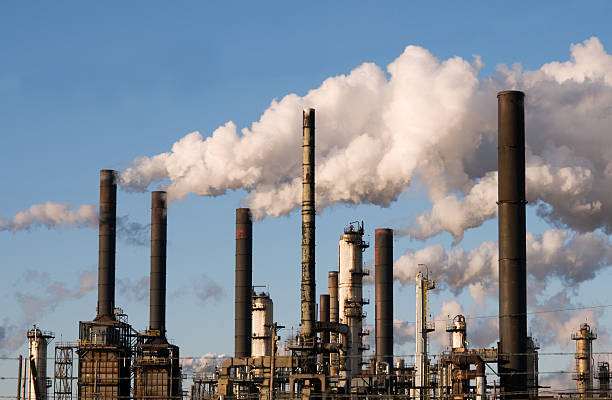 refinery with smoke stacks stock photo