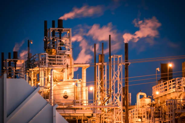 Refining facilities lighted in industrial glow stock photo