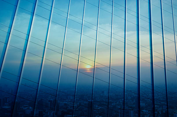 Reflect of aerial view of cityscape at sunset on wall stock photo