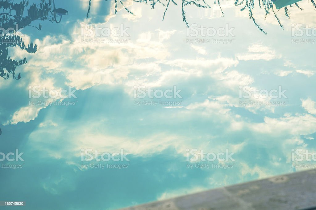 Reflected clouds on the pool's water royalty-free stock photo