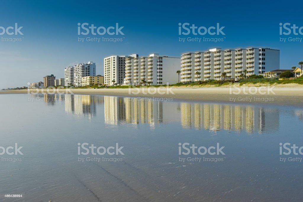 Reflected Condos on Sandy Beach stock photo