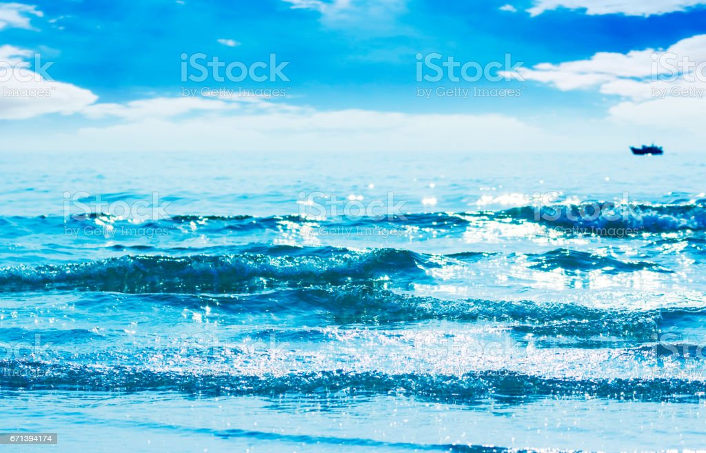 Reflected of sunlight on blue waves stock photo