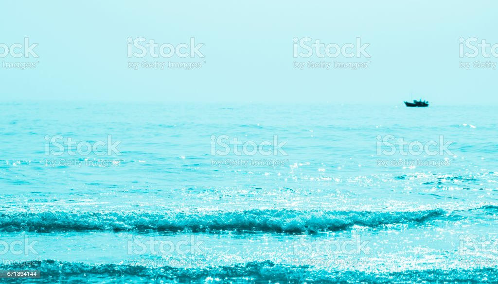 Reflected of sunlight on turquoise waves stock photo